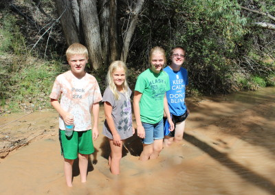 Playing in the quicksand, Kanab, Utah