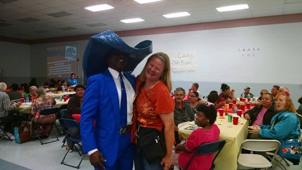 Mom and the Man in the Big Blue Hat at the Joe Salem Thanksgiving Dinner at the Boys and Girls Club in Corpus Christi, TX